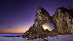 unique rock formation with purple sky